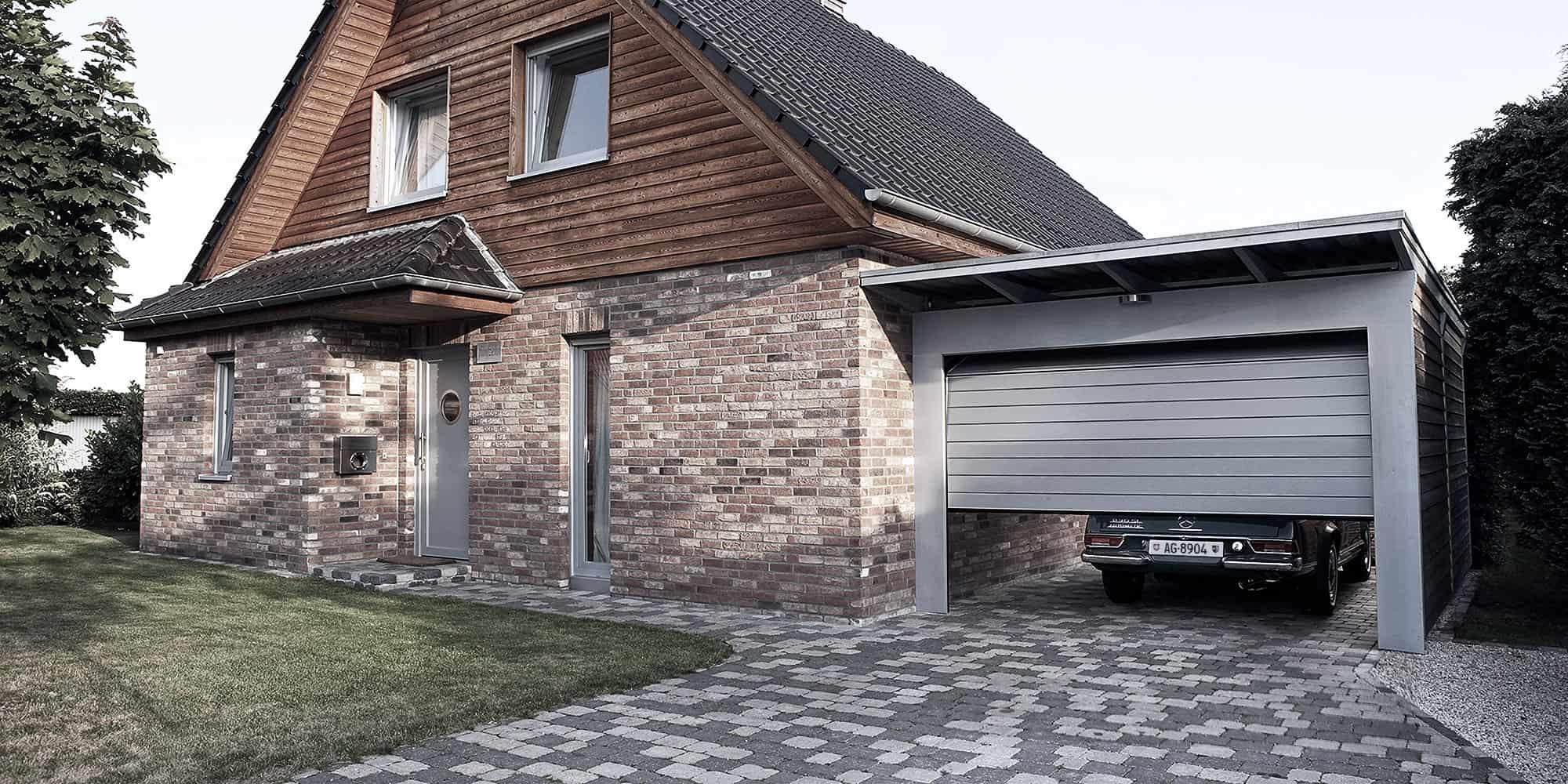 uninorm fertiggaragen carports garagentore gartenh user. Black Bedroom Furniture Sets. Home Design Ideas